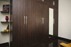 Hinged wardrobes are practical and work well even in small rooms. Unlike sliding wardrobes, you can view everything inside at one shot. Wooden finish is a classic choice that won't go out of style. Beautiful Houses Interior, Beautiful Interiors, Modular Wardrobes, Wardrobe Storage, Free Interior Design, Wardrobe Design, Small Rooms, Interior Inspiration, Living Room Designs