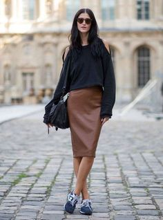 $37 Loving the sophisticated approach to wardrobe classics, such as this cut-out shoulder long sleeves sweater paired with brown midi skirt and sneakers.