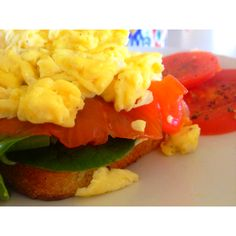 Breakfast of champions - onion & chive cream cheese, smoked salmon, spinach, scrambled eggs on multi-grainy bread <3