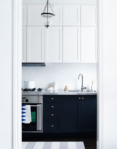 Love the mix of steel and brass, and the navy cabinets are great.