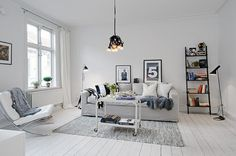 Swedish real estate site Alvhem us carry on to provide you with beautiful Scandinavian interior. Now we have a nice flat bottom white with uncommon decorations black and gray. The apartment was in the old house of the 19th Century century (and ceiling), and only about 80 square meters. m compact housed three bedrooms (two with the old classic fireplace). and kitchen We will show, that white is better!
