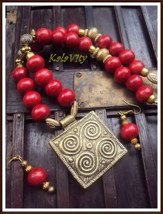 Ethnic necklace with cherry red drops and metal combination