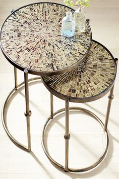 Indulge your nesting instinct. Handcrafted in India, tempered glass and powder-coated iron form glittering medallions in two nesting sizes. The top of each Pier 1 Sparkle Mosaic Nesting Table is a golden starburst mosaic of polished glass. Hand-forged bases of wrought iron with decorative metal beads are painted black for added contrast. The larger table base is partially open to accommodate its smaller companion.