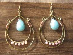 https://www.cityblis.com/1283/item/12808  Tangiers - $54 by TarajamuDesigns  Tangiers double hoop, hand wrapped earrings is a mixed metals design.  Golden Brass & Copper with semi-precious Pink Coral and Amazonite (image shown).  Natural stones may vary due to availability and color desired when ordered.  Beautiful and sexy is what everyone will say when they ask where did y...
