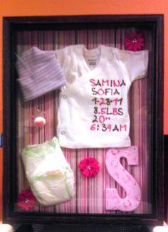 Shadow box of my baby girl's new born items! :o)