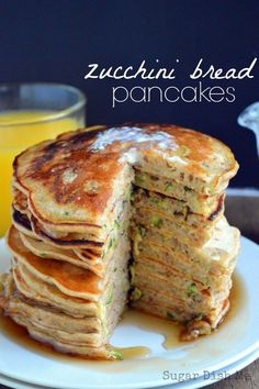 Zucchini Bread Pancakes - Fluffy buttermilk pancakes loaded with fresh shredded zucchini, cinnamon, nutmeg, and brown sugar. Zucchini Bread Pancakes are a perfect breakfast and a great way to use up some of those garden veggies!