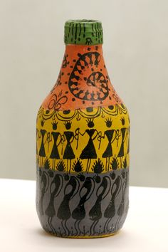 Collectors item.Beautiful Warli Painted glass bottle for $30