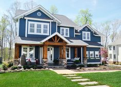 "The Clover won ""Best Curb Appeal"" at the 2013 Homearama. If you click into this website you will be able to view a video produced by Young House Love Blue Siding, Exterior Siding, Exterior Design, Wood Siding, White Siding, Home Styles Exterior, Tin Siding, Cafe Exterior, Wood Facade"