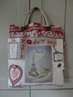"""Men neme: kleine borduurwerkjes, oude hangertjes met de Eiffeltoren, een """"diamanten"""" hart, kleine stoffen hartjes, band met strikjes, een b..."""