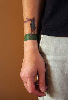 A tattoo of: if you can read this, it is probably windy - Marc Johns