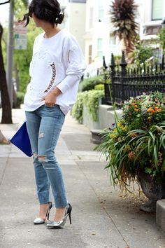.looks like a weird sweatshirt with ripped jeans and heels... totally crazy combo.