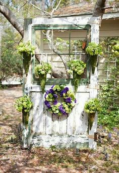 An salvaged door used as a place to display planters. - My Garden Decor List Garden Whimsy, Garden Cottage, Garden Doors, Garden Fencing, Garden Yard Ideas, Garden Projects, Rustic Gardens, Outdoor Gardens, Old Door Decor