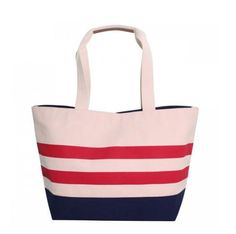 NAUTICAL STRIPED TOTE -  large nautical inspired boat bag in natural canvas bag paired with a solid dyed navy bottom and two contrasting thick red stripes is sure to be your new summer favorite.  The inside pocket features one large zip closure compartment in addition to two wallet sized open pockets for keeping your essential accessories secure.