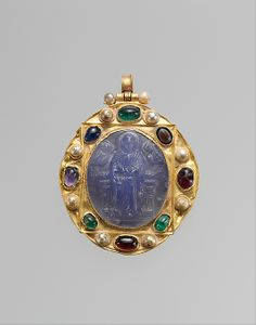 Pendant Brooch with Cameo of Enthroned Virgin and Child and Christ Pantokrator;Chalcedony cameo; gold mount with pearls, emeralds, garnets, sapphires, and a sardonyx intaglio. Byzantine, late 11th–12th century, mount 12th–14th century
