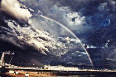 Brighton pier and a rainbow, UK.