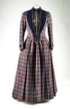 Circa 1885 wool tartan trimmed with dark green velvet day dress, British, via National Museums of Scotland.