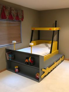 Bulldozer Bed (PLANS ONLY) in downloadable pdf format. A project you can build so your little one can transition to a big-kid bed they will love to sleep in!  The cost to build this bed is approximately $350 depending on local prices, and it can be built in just a few days!  Plans include: - Cut dimensions for all pieces - Materials and Quantities list - Step by step assembly instructions  So get started today and make this a fun family project!