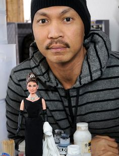 Noel Cruz, a professional doll repainter