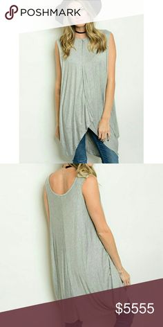 🌻JUST IN🌻 Sleeveless Tunic Top Light Gray tunic length sleeveless top. Draping detail on sides of shirt. Would look cute with a bralette or cami worn underneath! Arm holes are designed to be big. The fit is bigger, in my opinion. I typically wear a Medium but the Small fit fine (I'm a Size 8 Top/36DD). This is a NWOT Boutique item. Boutique Tops Tunics