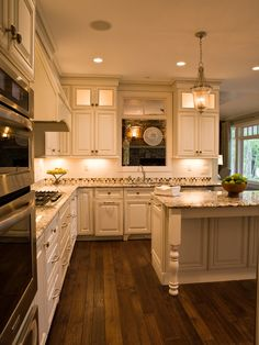 Different backsplash, wider planked, slightly darker wood floors, different hood over stove...otherwise my DREAM kitchen
