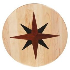 """Wood lazy Susan with nautical star inlay. Made in the USA.    Product: Lazy susanConstruction Material: Wood and metalColor: NaturalFeatures:  Decorative inlayMade in the USA Dimensions: 16"""" DiameterCleaning and Care: Clean with soap and water. Do not leave soaking in water. Not oven or microwave safe."""