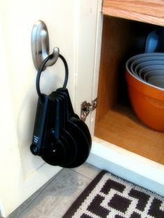 Use Command hooks to hang things on the inside of a cabinet door.