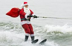 Santa Claus water-skis on the Potomac River near Washington, DC, on December 24, 2012, at the National Harbor in Maryland during th 27th Annual Water Skiing show. This unusual annual event features a water-skiing Santa, flying elves, the Jet-skiing Grinch, and Frosty the Snowman performing on the Potomac River. PAUL J. RICHARDS/AFP/Getty Images