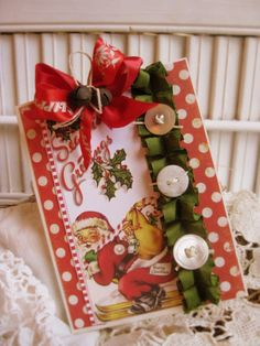 Cute and full of charm for someone during the holidays...papers, large tag image, double decked ribbons, rusty jingle bells and twine,