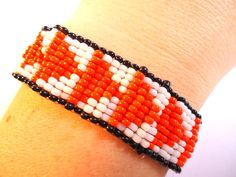 Orange triangle loom bracelet handmade by gypsyjennhandmade