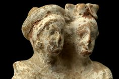 Greek terracotta figurine, Canosa, 3rd century B.C. Canosa terracotta figure, showing two female figures embracing, both wearing a long chiton and himation, with remains of pink pigment, 16 cm high. Private collection