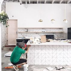"""RG from @citysage. Here is an in-progress shot of @lightlab! They opted for our 6"""" Triangle tiles in Calcite for this part of the space and we love it! We're so excited to see the end result!!  #tiles #triangles #design #designinspiration"""