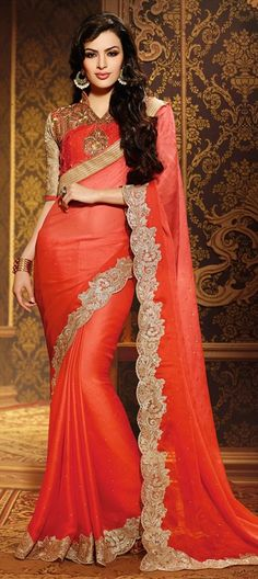Get monsoon ready with fiery orange designer saree by iws. 163526 Orange color family Embroidered Sarees, Party Wear Sarees in Faux Chiffon, Net fabric with Lace, Machine Embroidery, Stone work with matching unstitched blouse.