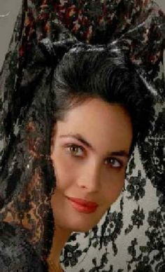 Europe | Portrait of a woman wearing a mantilla and peineta, Spain #lace