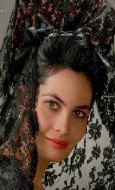 Europe | Portrait of a woman wearing a mantilla and peineta, Spain #lace #veil