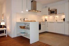Küche offen zum Wohnbereich: der Tresen dient sowohl als optische Trennung als auch als Stauraum! Toll gemacht! (Schloss am Meer - Föhr / Whg.18)