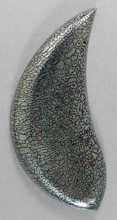 pyritized Dinosaur Bone cab, Silverhawk's designer gemstones.