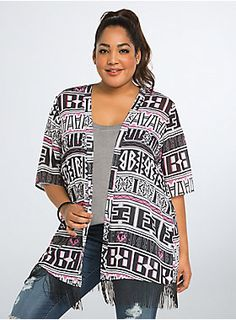 """<p>This geo print kimono is boho meets Barbie! Black, white, and pink - of course - Barbie logo graphics are printed alongside a few of her fave things - shoes and lipstick. Black fringe lends a moving and shaking touch to the sheer style.</p>  <p></p>  <p><b>Model is 5'10"""", size 1</b></p>  <ul> <li>Size 1 measures 33 7/8"""" from shoulder</li> <li>Polyester</li> <li>Wash cold, dry low</li> <li>Imported plus size kimono</li> </ul>"""