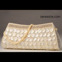 White Silk Handbag White silk fabric handbag delicately adorned with white handcrafted beads and mother of pearl,highlighted with crystals. Indian Accessories, Fabric Handbags, Bridal Clutch, Wedding Purse, Beaded Bags, White Beads, White Silk, Henna Designs, Indian Bridal