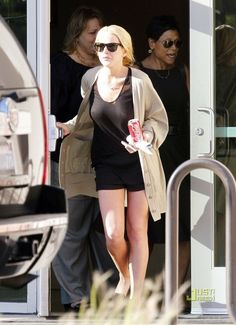 Lindsay Lohan wearing Ray-Ban 3016 Clubmaster Sunglasses and Topshop Kosy Leopard Print Suede Slippers.