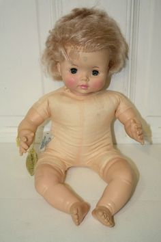 """Vintage Effanbee 'Sweetie Pie' sleepy eye doll with tag. $25 neck 1969 Effanbee 14 9469 move her from lying down to sitting up and she cries. 16.5"""" Blue eyes, blonde hair. **Green spot on forehead**"""