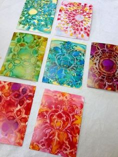 Yupo paper with alcohol inks through stencils. More