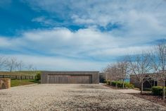 Garage. 'Solterra' in the spectacular high country of Victoria, Australia. Rammed earth and ironbark
