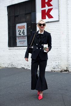 pinstripe suit with architectural pants and loafers