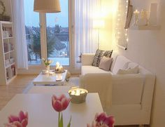 Despite this all white scheme and tiny room there is no lack of warmth due careful choice of accessories.