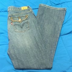 Levi's boot cut 515 jeans size 10 These are adorable jeans in great condition with normal signs of wear. Levi's Jeans Boot Cut