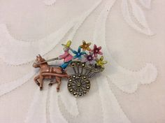 Vintage Marcasite Horse and Cart Brooch. Hand Painted. by Vintage0156 on Etsy https://www.etsy.com/listing/214492715/vintage-marcasite-horse-and-cart-brooch