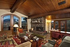 69 Herron Hollow Road - Listing # 125852 - Price: $7,975,000 - The ''Fifth Avenue'' of locations in Aspen situated on over an acre of extraordinary mountain view property. The views abound from all the living areas, wrap around decks and private patios. Completely refurbished in 2010 the home comes complete with the finest furnishings and finishes. Special features include a billiards room, den/office, and gym on lower level.
