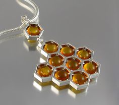 Exquisite Honeycomb Jewelry Pays Homage to the Natural Beauty of Bees - My Modern Met