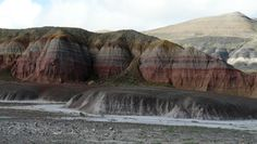 The Pryor is the lowest member of the Cretaceous Cloverly Formation, which like the Morrison is mostly fluvial and terrestrial in origin (both dinosaurs and terrestrial plants have been reported). It contains at least one tuff (a volcanic ash deposit), and numerous bright red paleosols:
