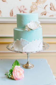 Give your wedding reception an elegant feature with one of these beautiful wedding cakes with delicate details! Both pastel colors and floral arrangements can create a perfectly feminine look that will match your elegant wedding. These cakes are beautiful and will create simple sophistication for any wedding! Check them out below.